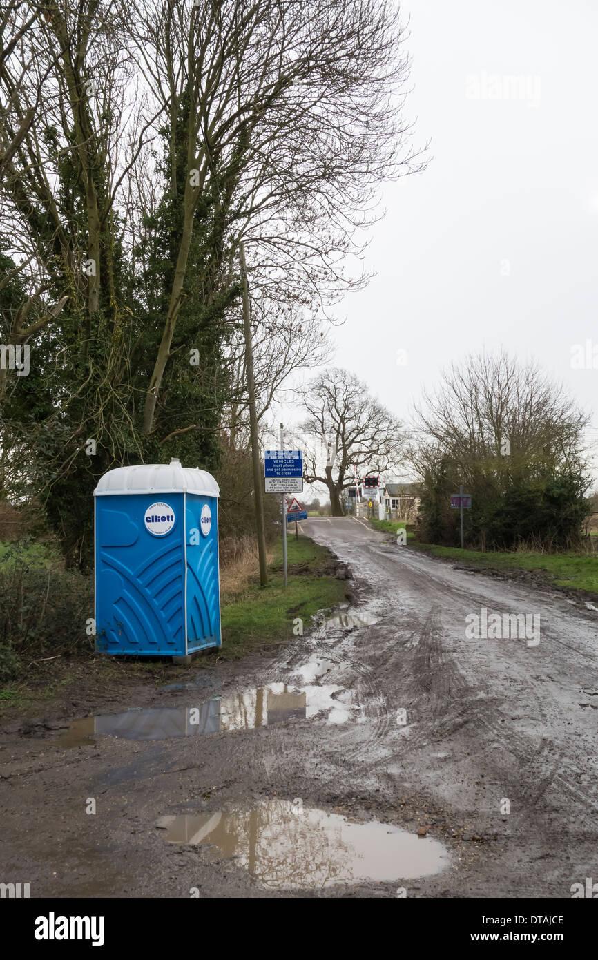 portable-toilet-at-side-of-lane-near-level-crossing-DTAJCE.jpg