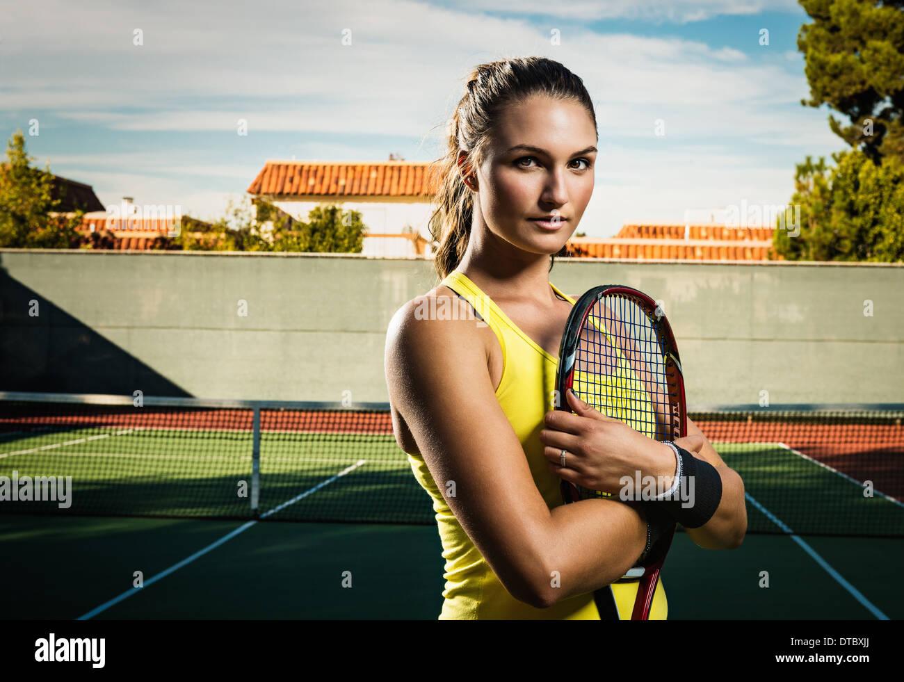 Female tennis player holding racket - Stock Image