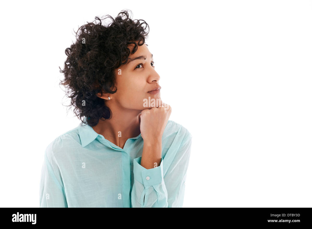 Portrait of confused and uncertain hispanic business woman on white background - Stock Image
