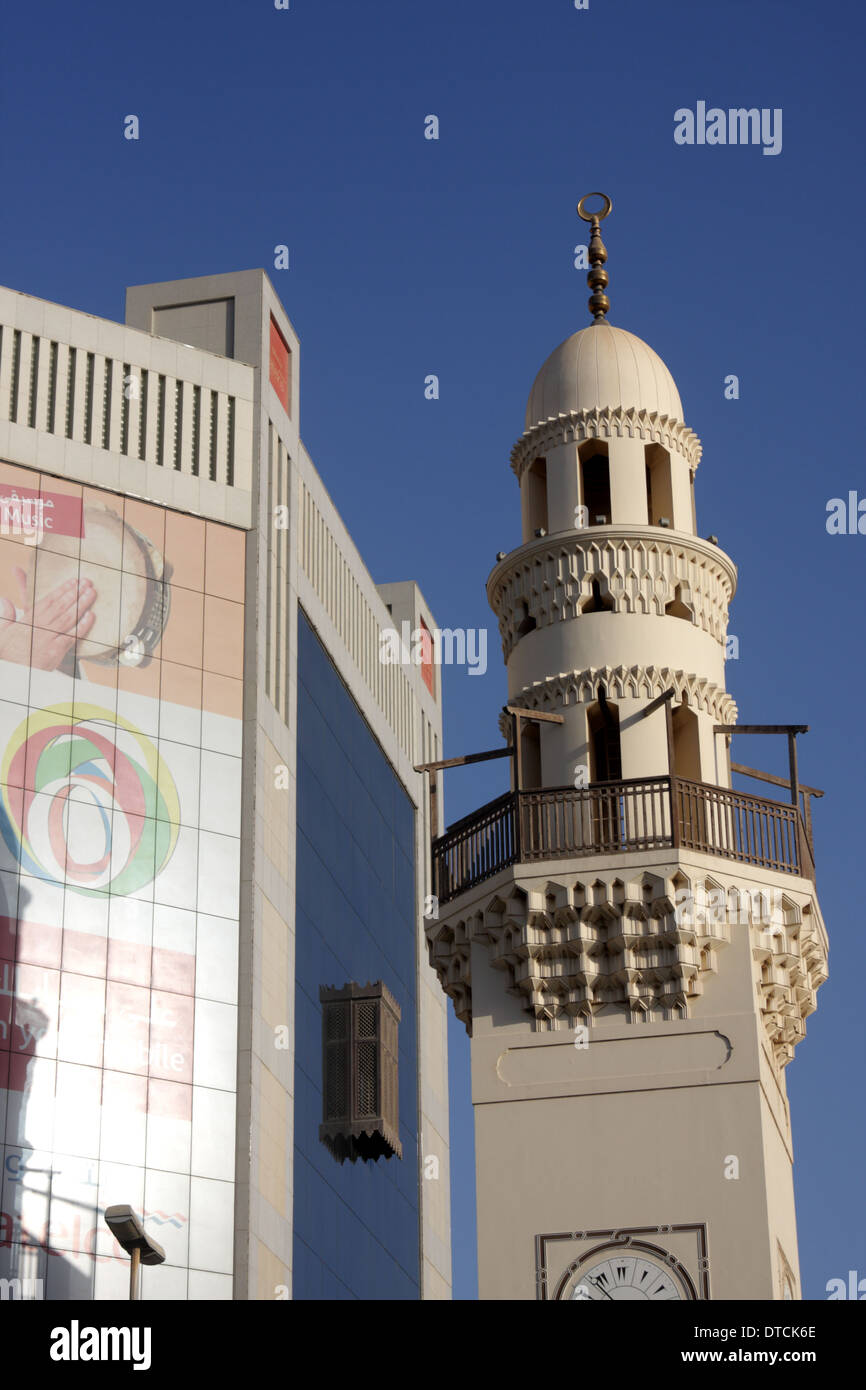 Minaret of the Al Yateem Mosque, next to the Batelco Building, Manama, Kingdom of Bahrain - Stock Image
