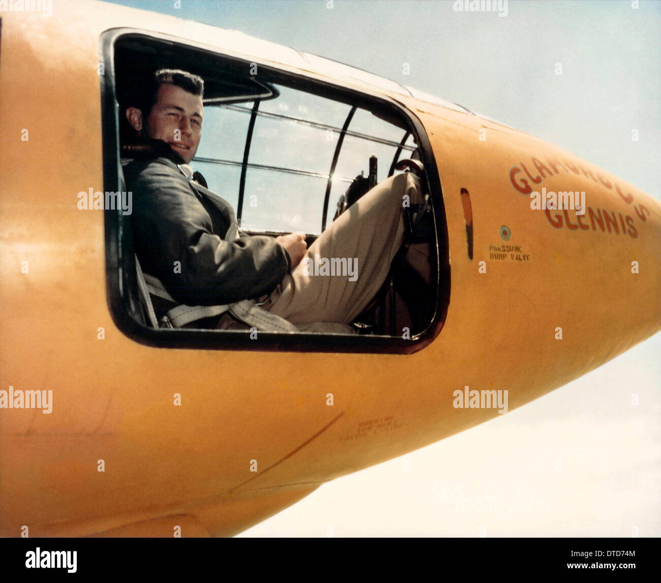 US Air Force test pilot Captain Chuck Yeager sitting in the cockpit of Glamorous Glennis the Bell X-1 aircraft that Stock Photo