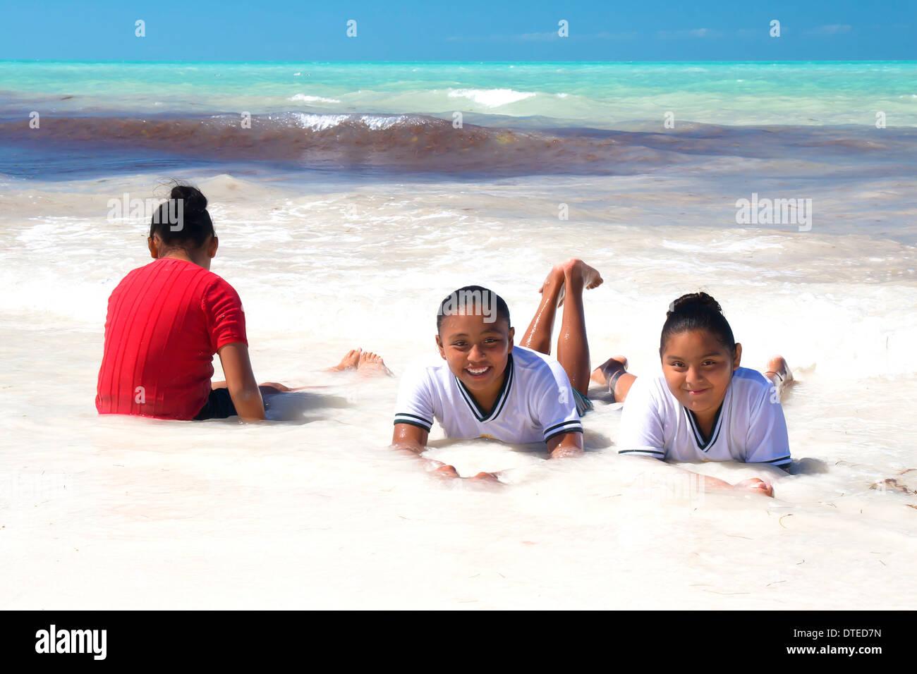mexican-girls-in-their-school-uniforms-enjoying-the-warm-waters-of-DTED7N.jpg