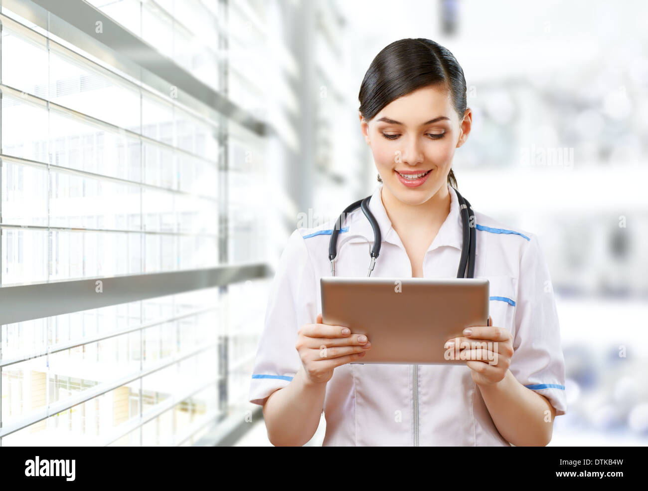 a woman holding a tablet pc - Stock Image
