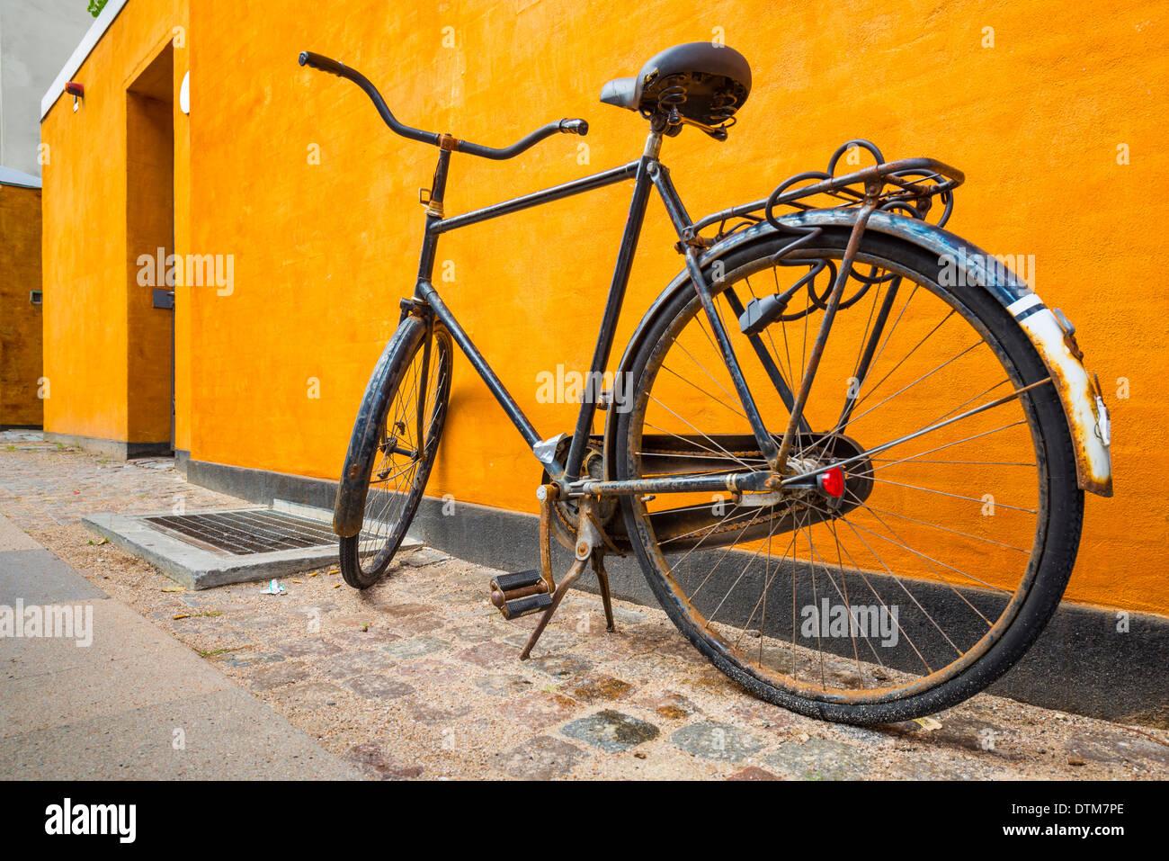 A bike on the sidewalk in Copenhagen, Denmark. - Stock Image