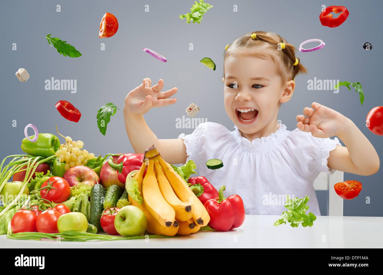 A beautiful girl eating fresh fruit - Stock Image