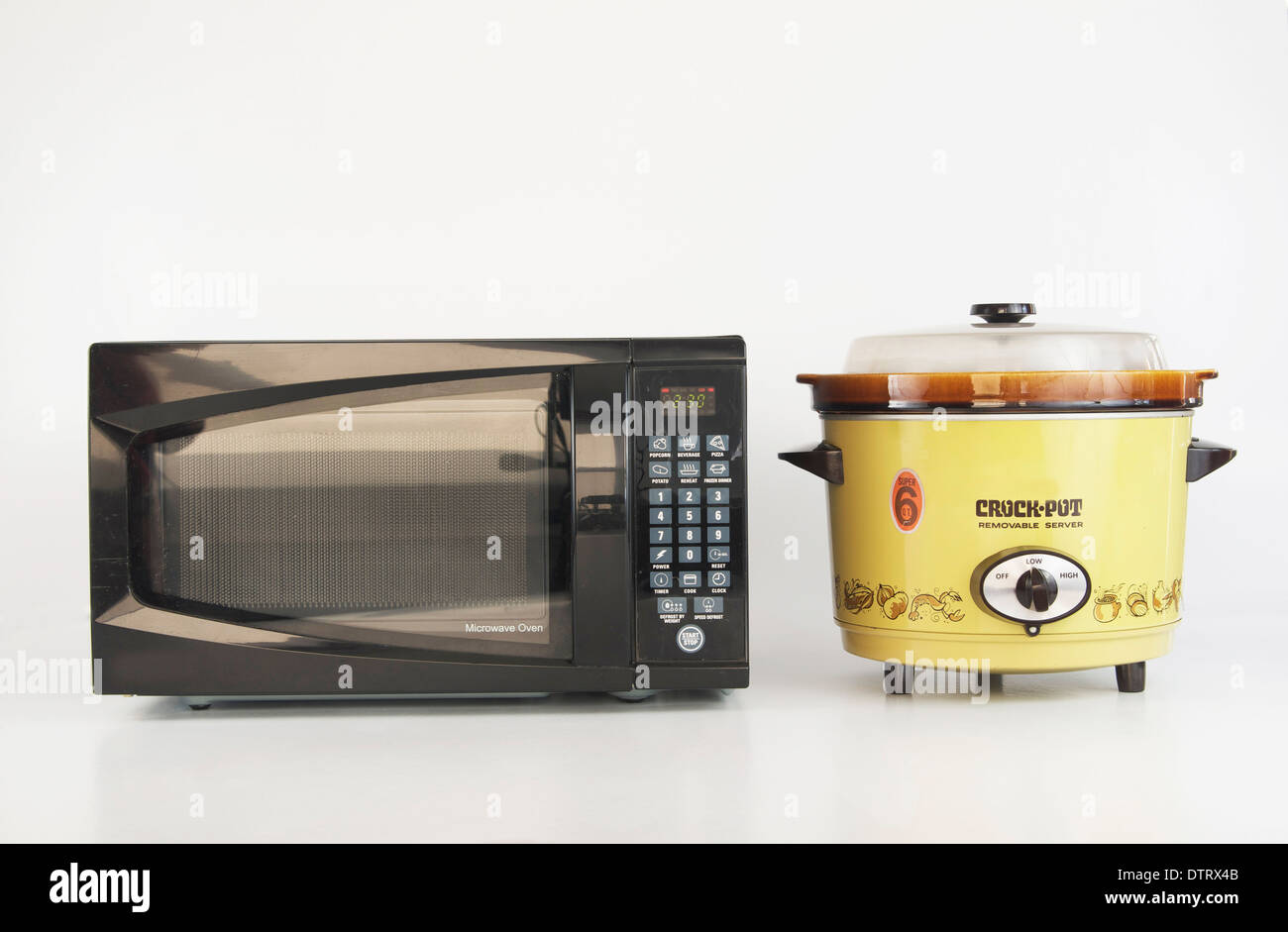 Microwave versus Slow Cooker Stock Photo