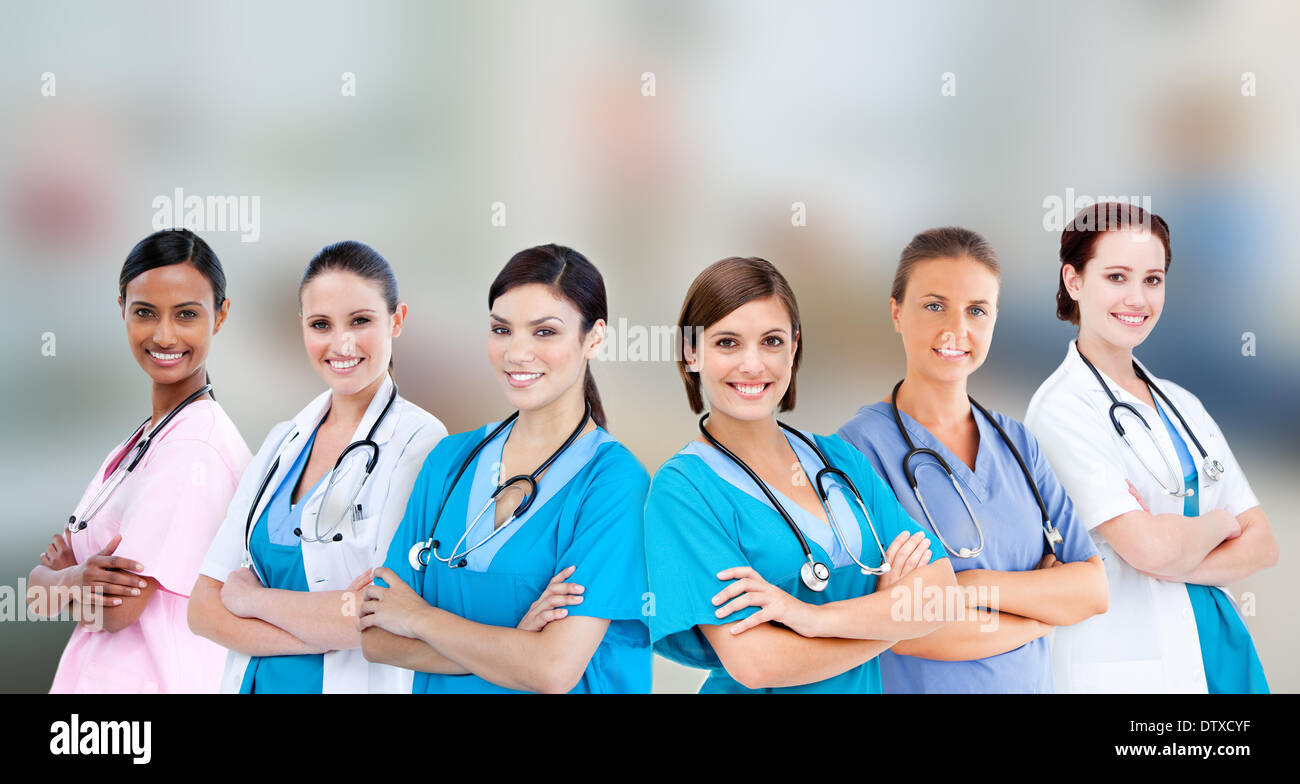 Female hospital workers standing arms folded - Stock Image