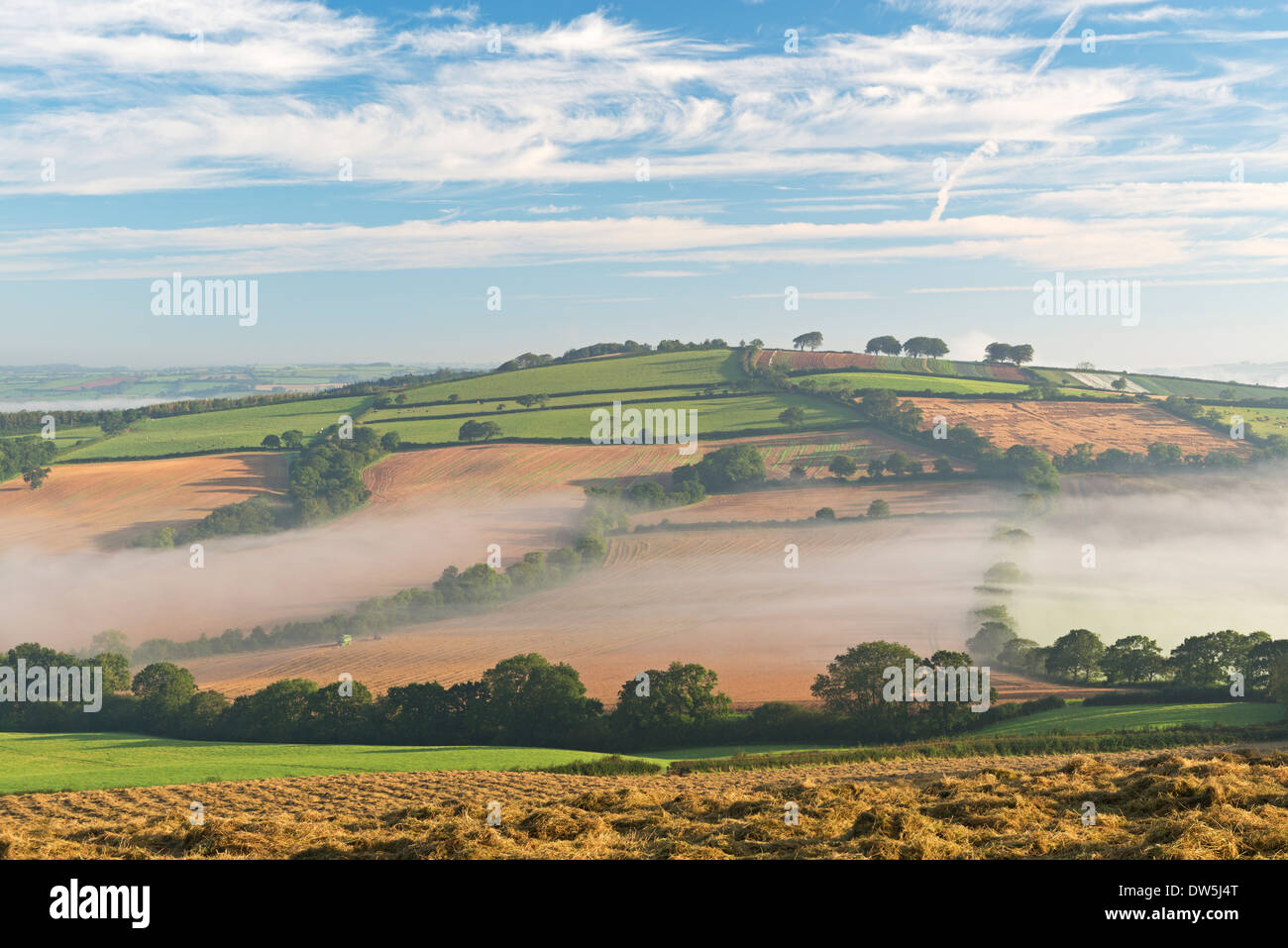 Mist covered rolling countryside at dawn, Near Crediton, Devon, England. Autumn (September) 2012. - Stock Image