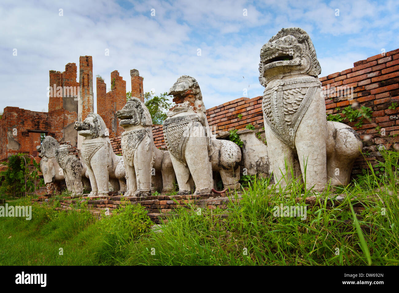 Stone mythical creatures like lions in the ruins of an ancient temple. Thailand, Ayuthaya - Stock Image