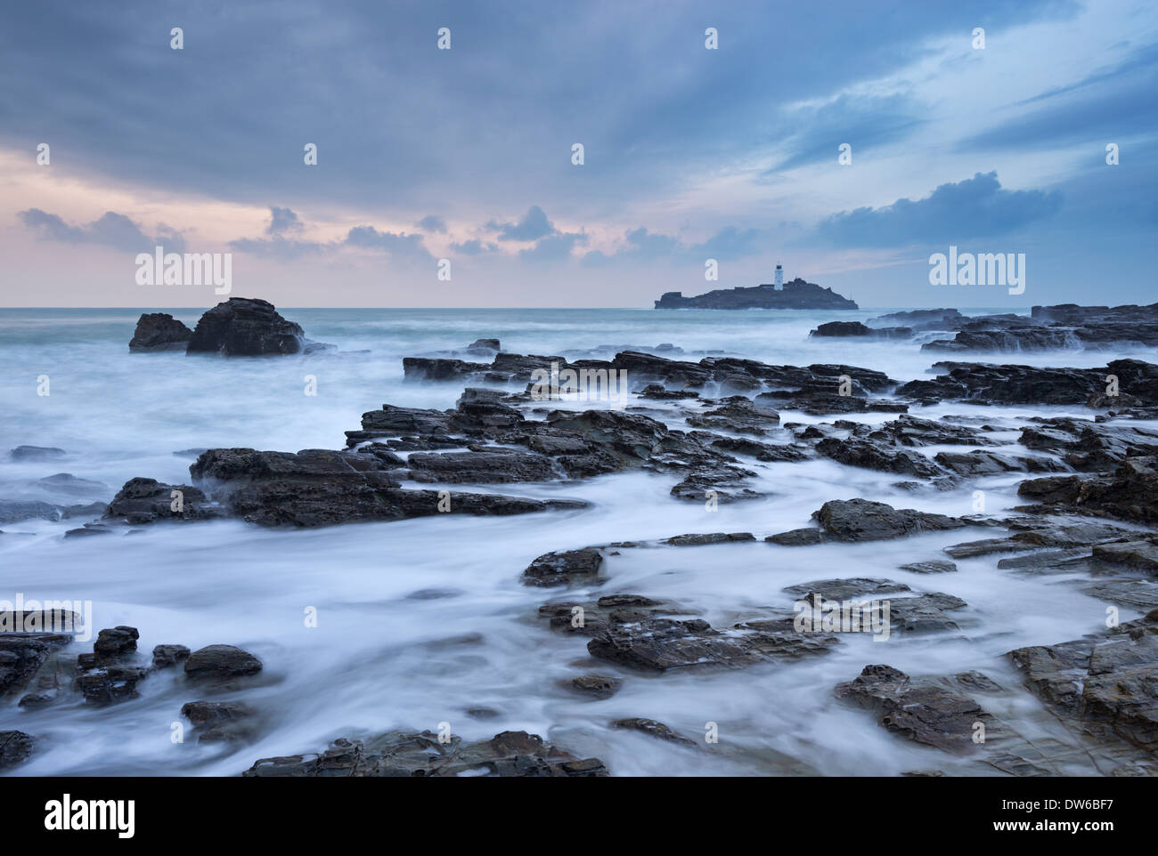 High Tide at Godrevy, looking towards Godrevy Lighthouse, St Ives Bay, Cornwall, England. Winter (January) 2014. - Stock Image