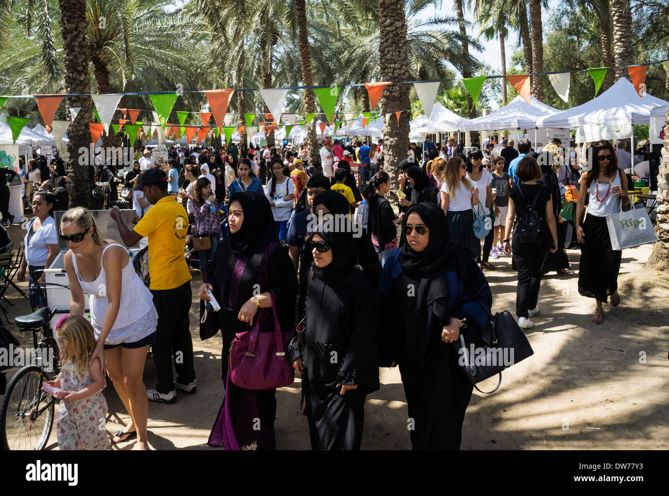 Busy food market held on holiday Fridays in Al Safa Park in Dubai United Arab Emirates - Stock Image