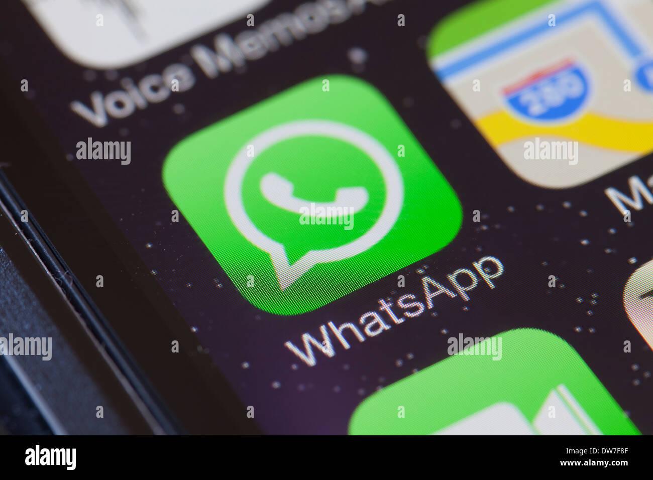 WhatsApp app icon on mobile phone. Stock Photo
