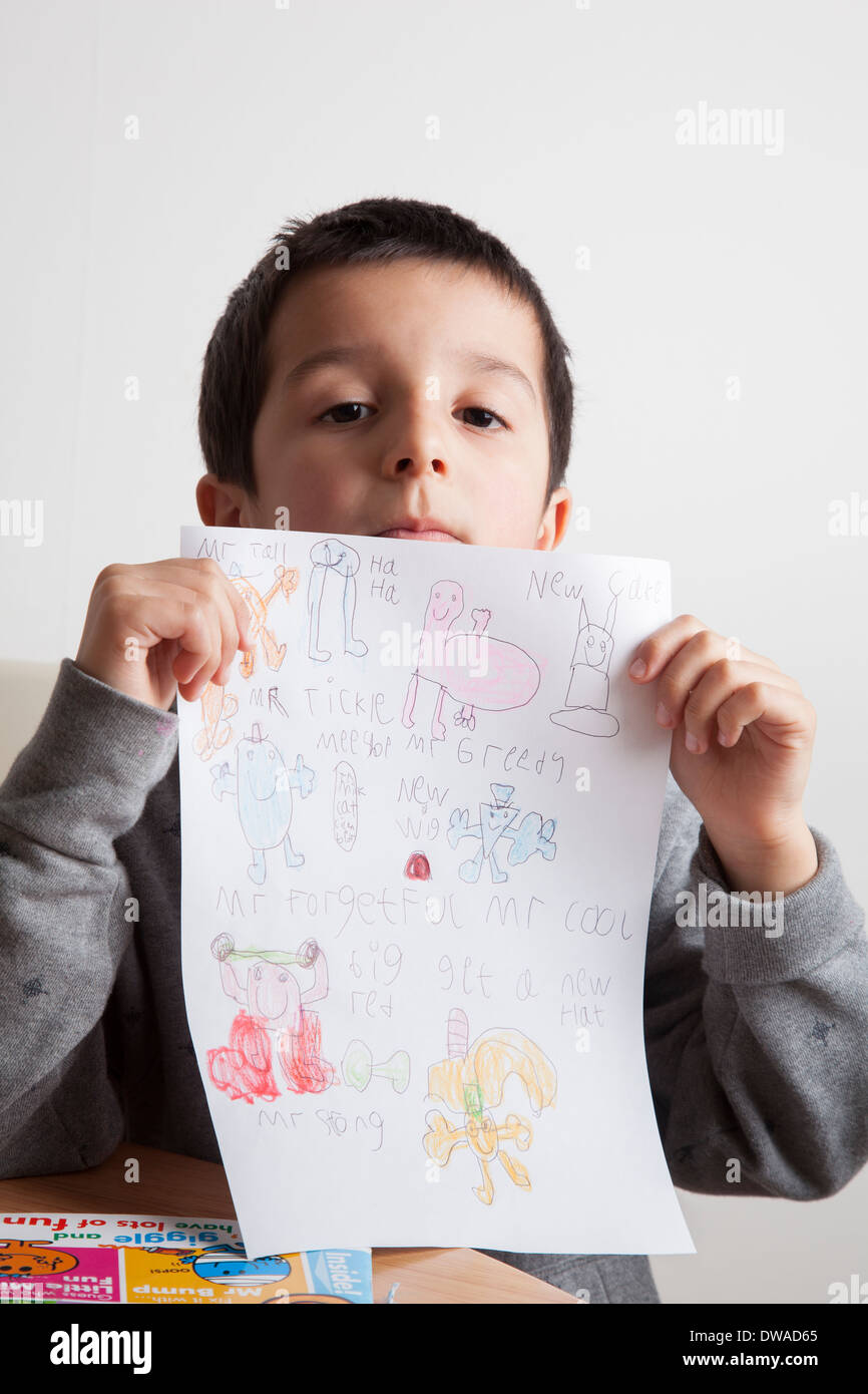 Boy shows drawing - Stock Image