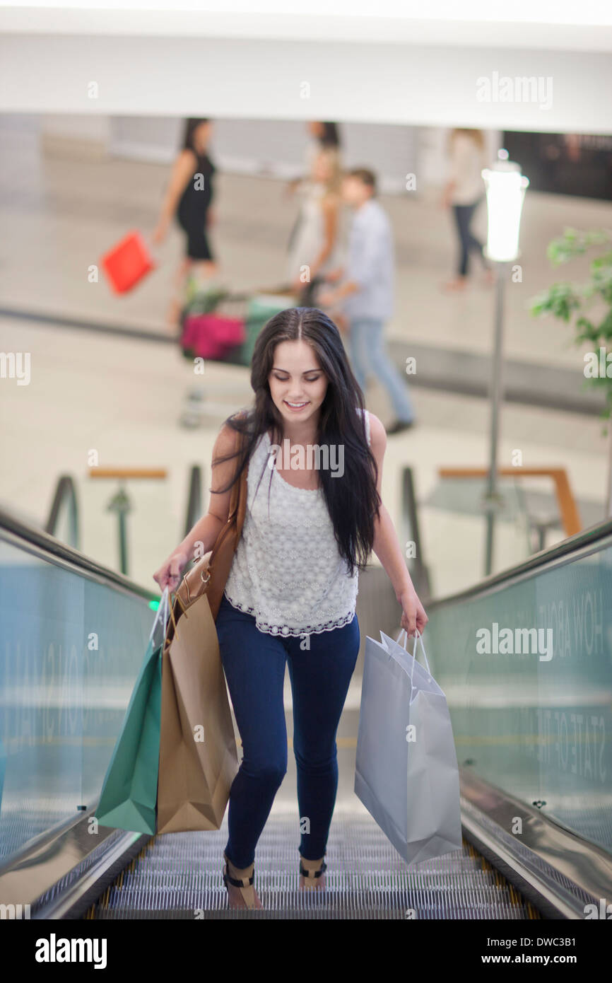 Young woman on shopping spree - Stock Image