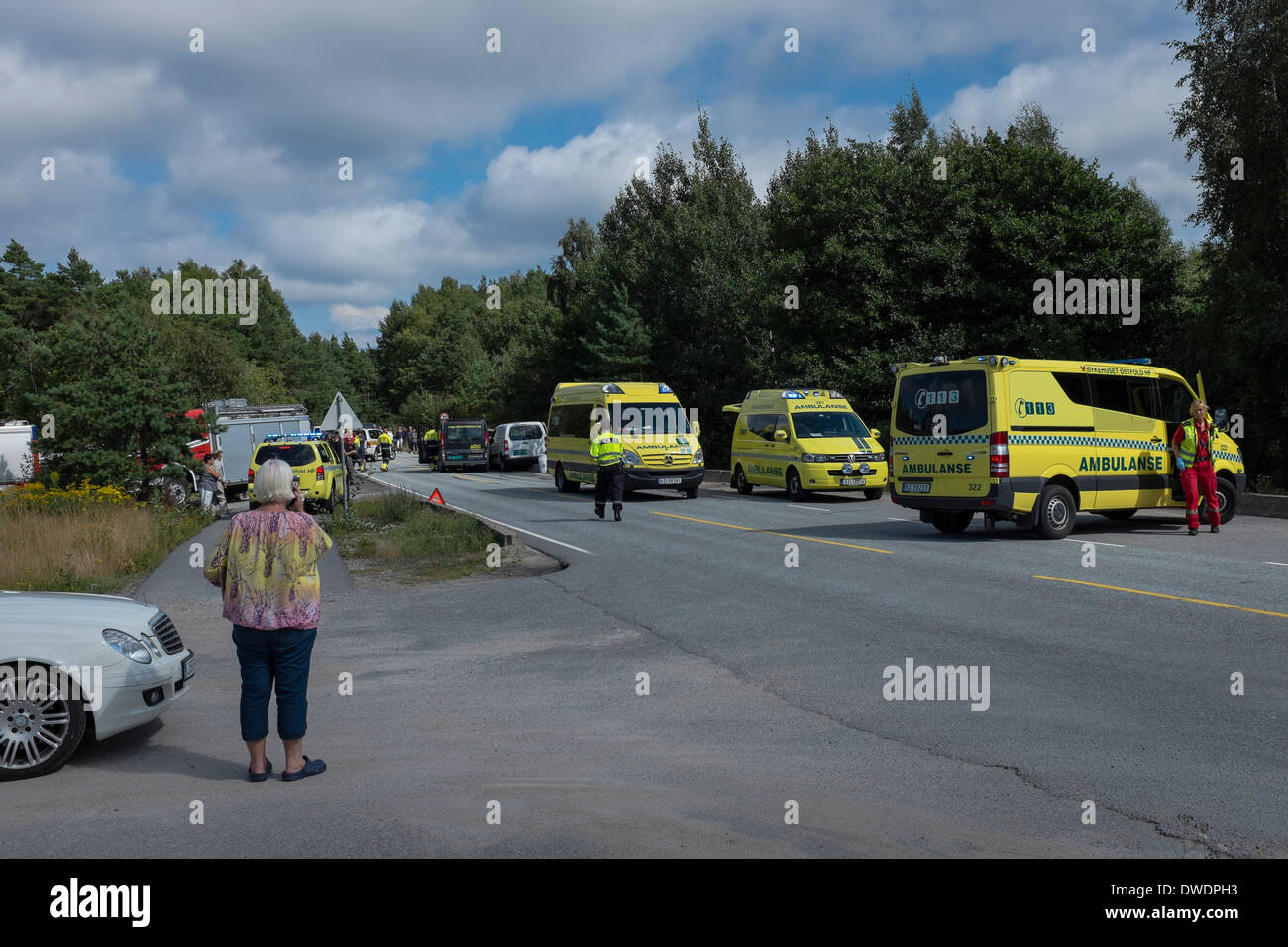 Minutes after the ambulance crew have arrived at a road accident scene in Norway. - Stock Image