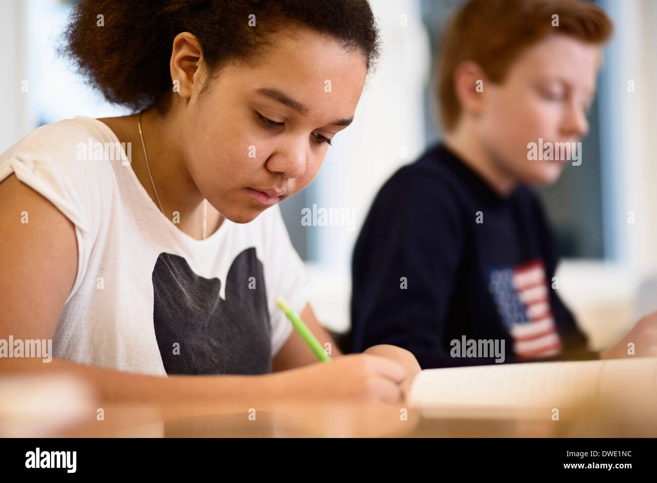 High school girl studying in class - Stock Image