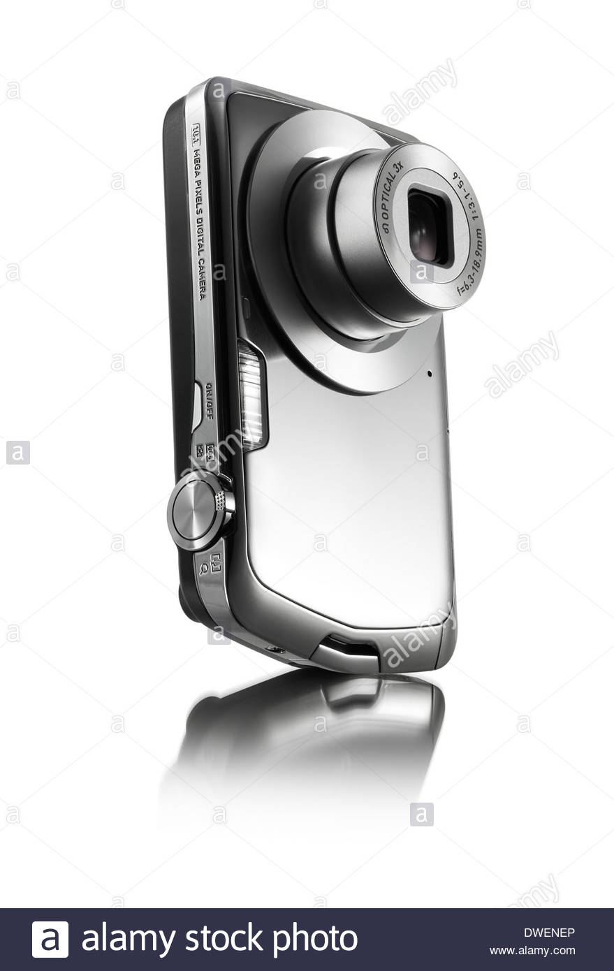 shiny silver or stainless steel compact pocket personal digital camera with flash and zoom lens - Stock Image