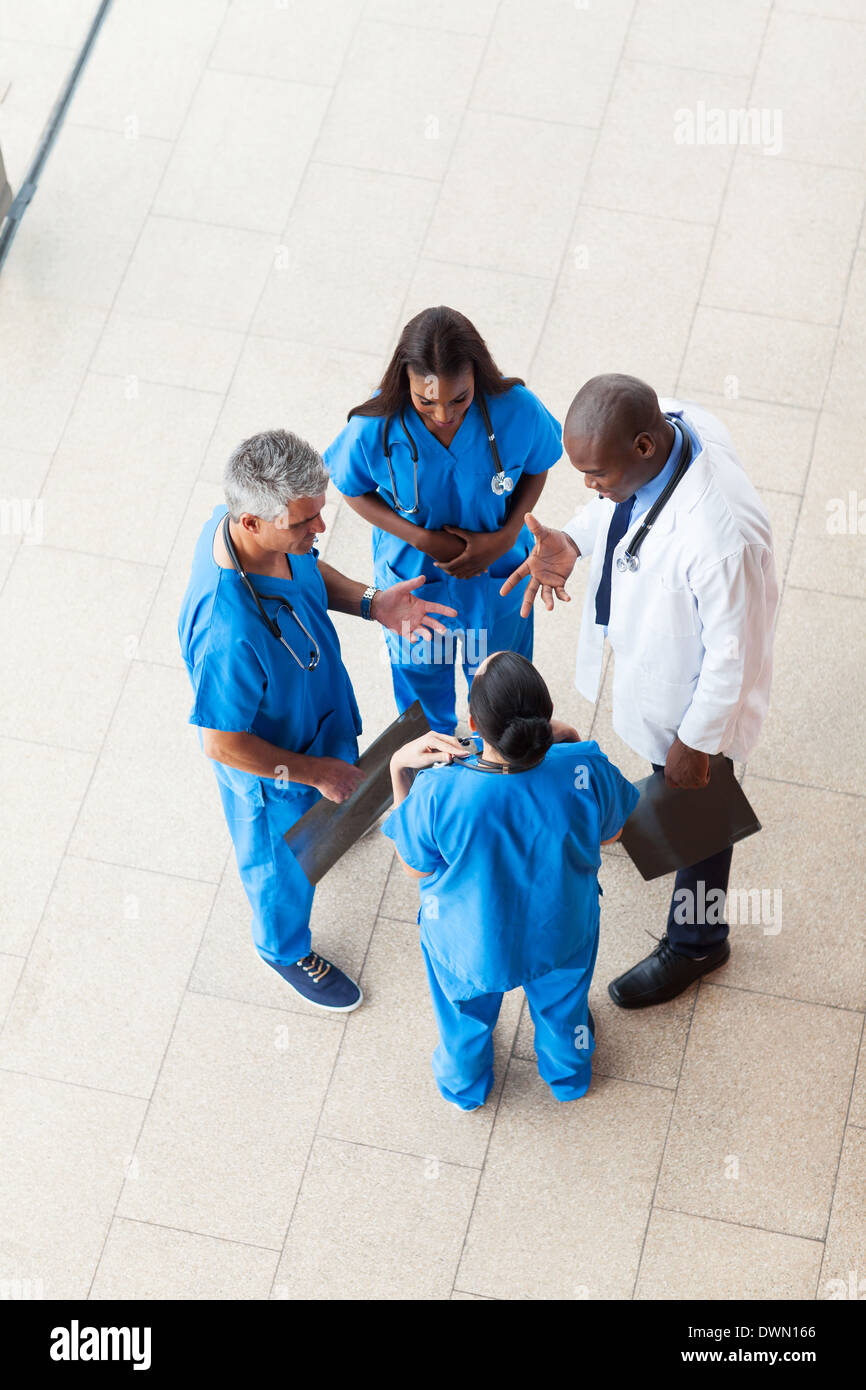 overhead view of medical workers having a meeting at hospital - Stock Image