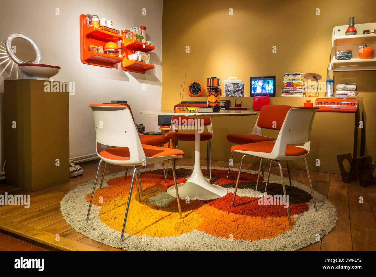 Orange living room interior showing home furniture of the seventies ...