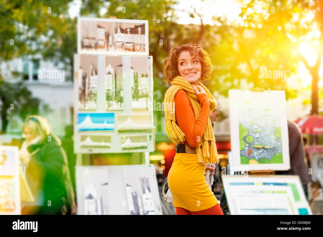 Paris, Woman Walking through Place du tertre, Montmartre - Stock Image