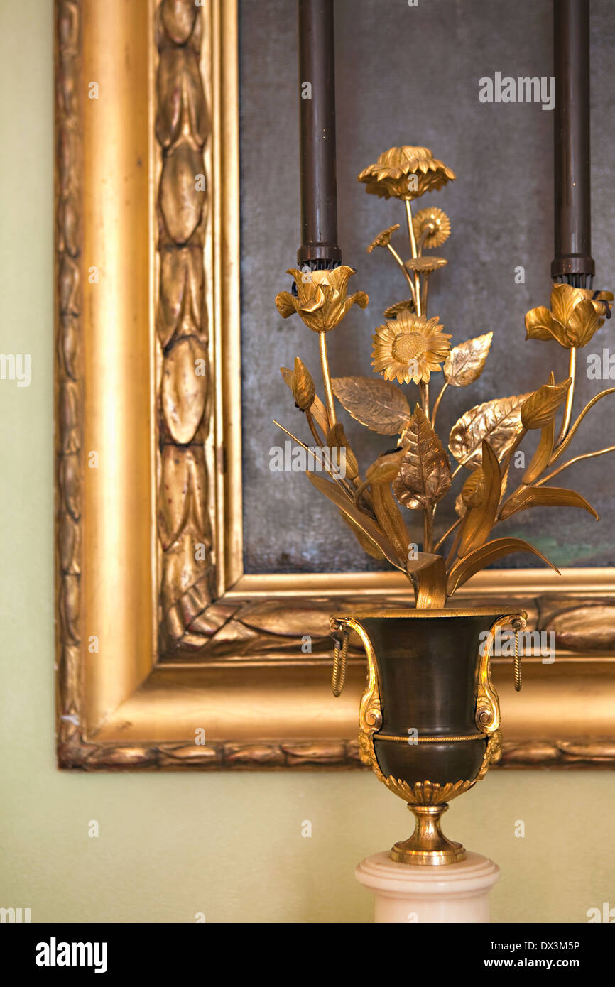 Ornate golden floral sculpture and picture frame - Stock Image