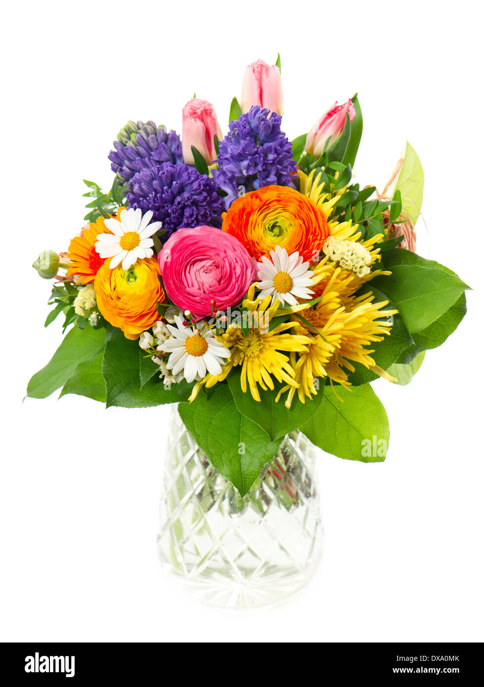 beautiful bouquet of colorful spring flowers in a glass vase. tulip ...