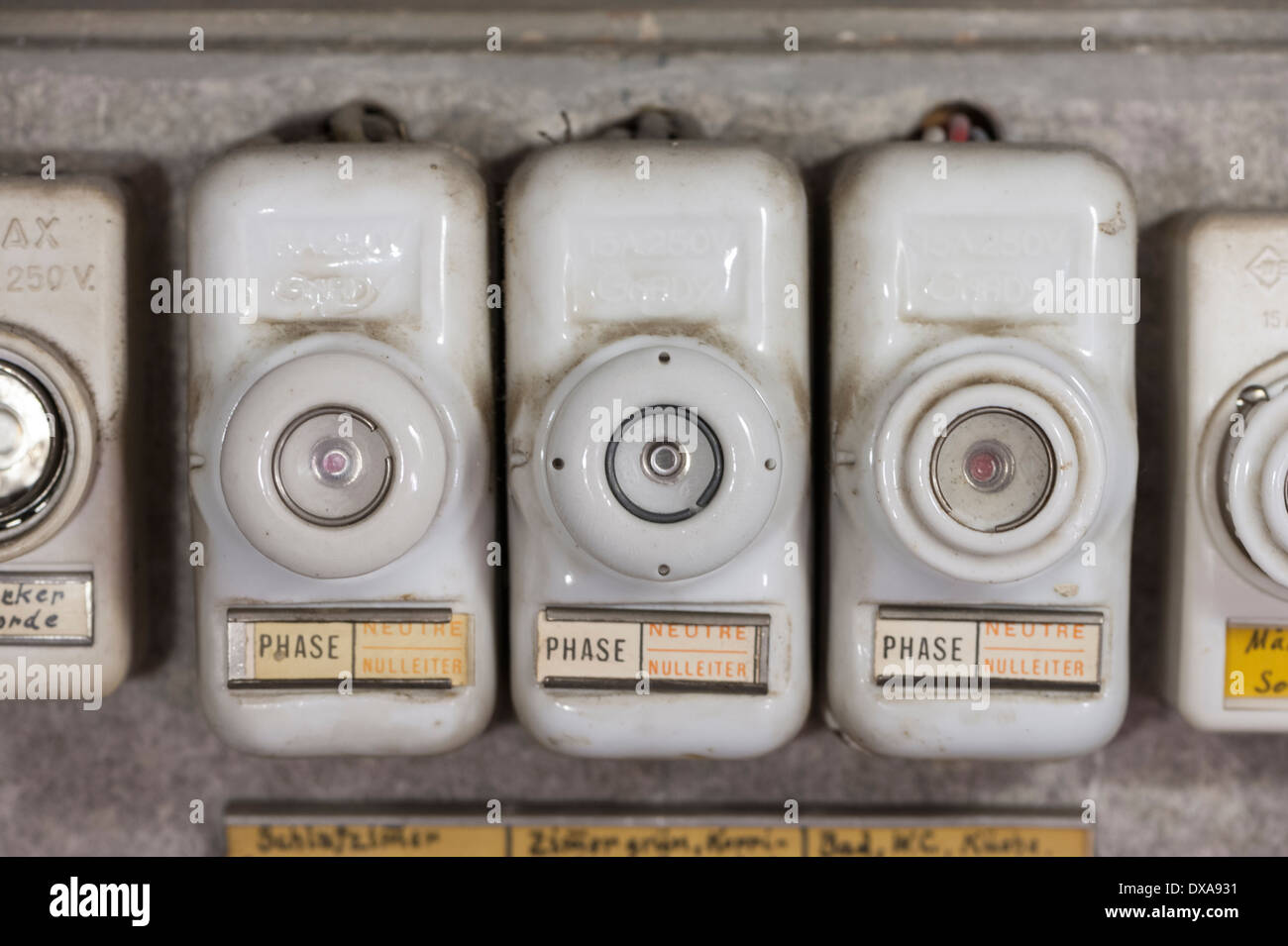 Close-up of an array of old-fashioned lead fuses in a household fuse-box (Swiss model, built around the 1970ties) - Stock Image