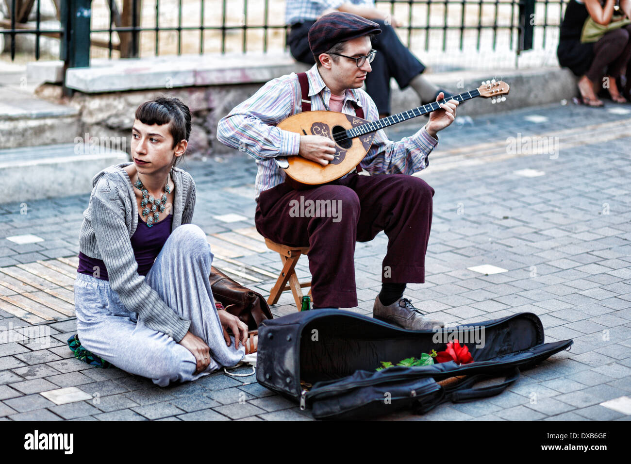 Musicians playing bouzouki in the street of Athens, Greece - Stock Image