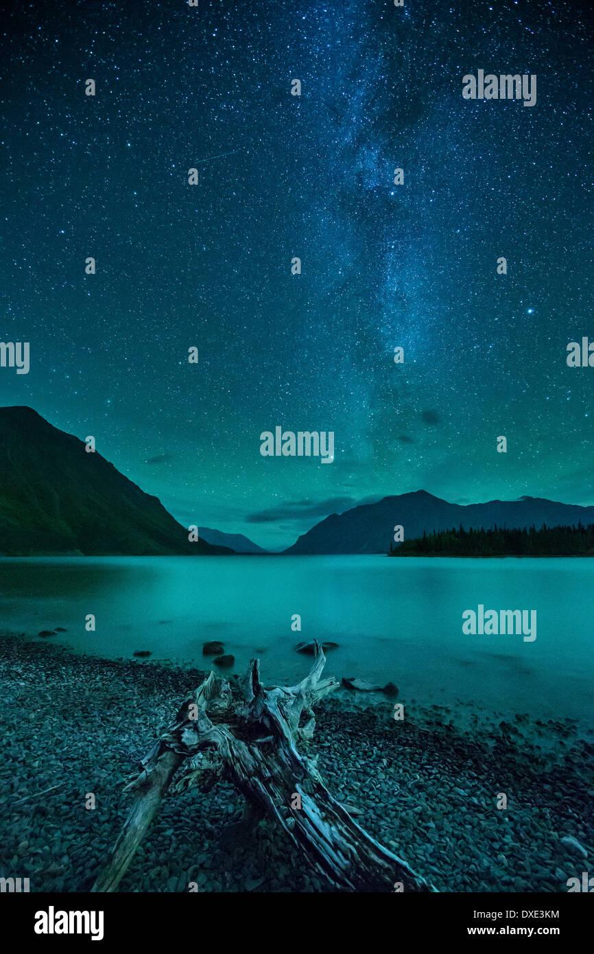 the Milky Way and night sky over Kathleen Lake & the St Elias Mountains, Kluane National Park, Yukon Territories, - Stock Image
