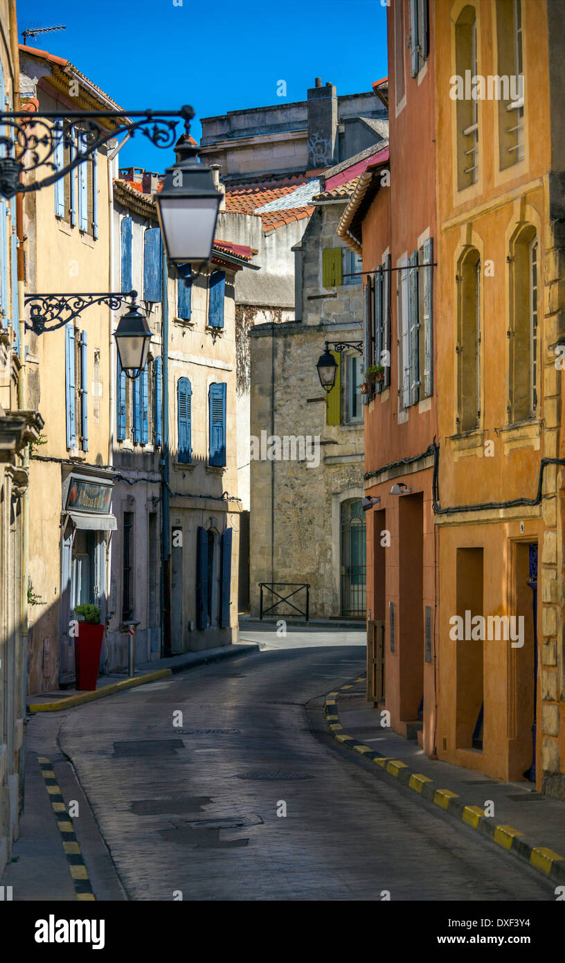 A narrow street in the old town of Arles in Provence in the South of France. Stock Photo