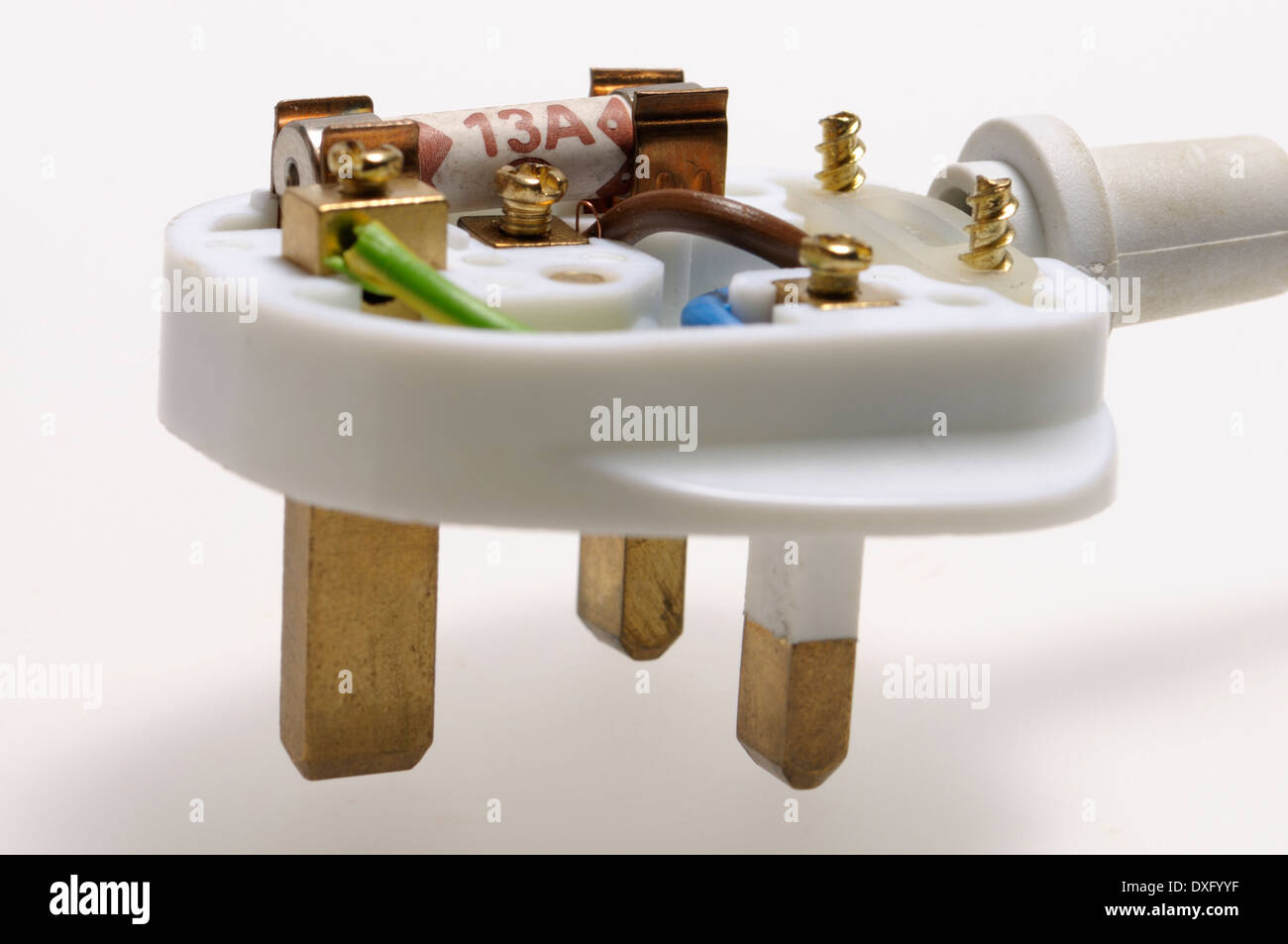 British 3-pin electric plug, with top removed to show fuse and wiring - Stock Image