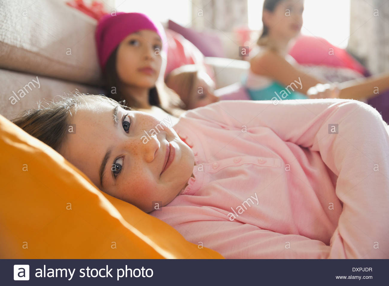 Girls hanging out at slumber party - Stock Image