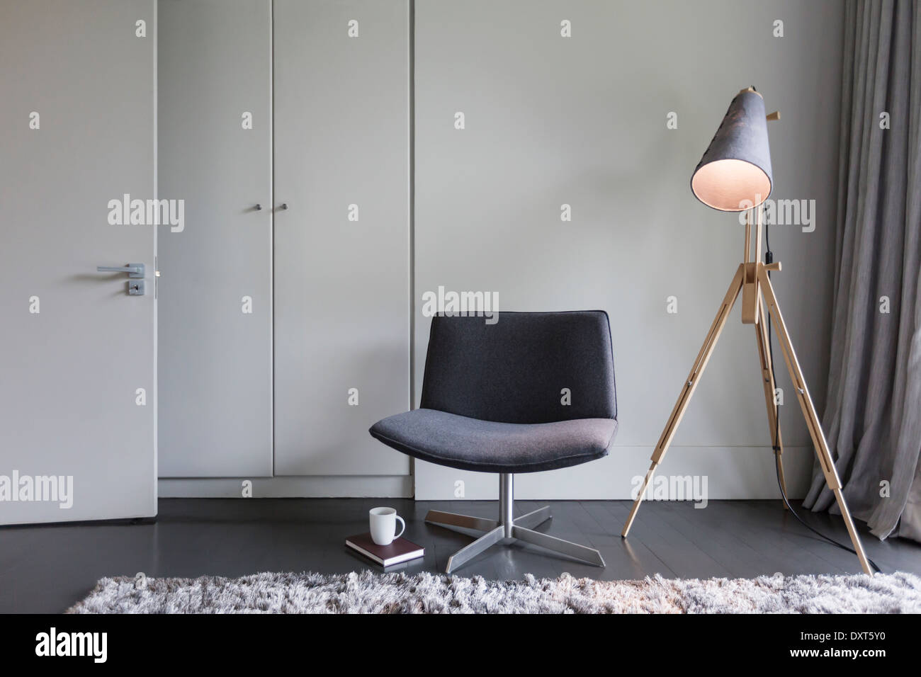Modern chair and lamp - Stock Image