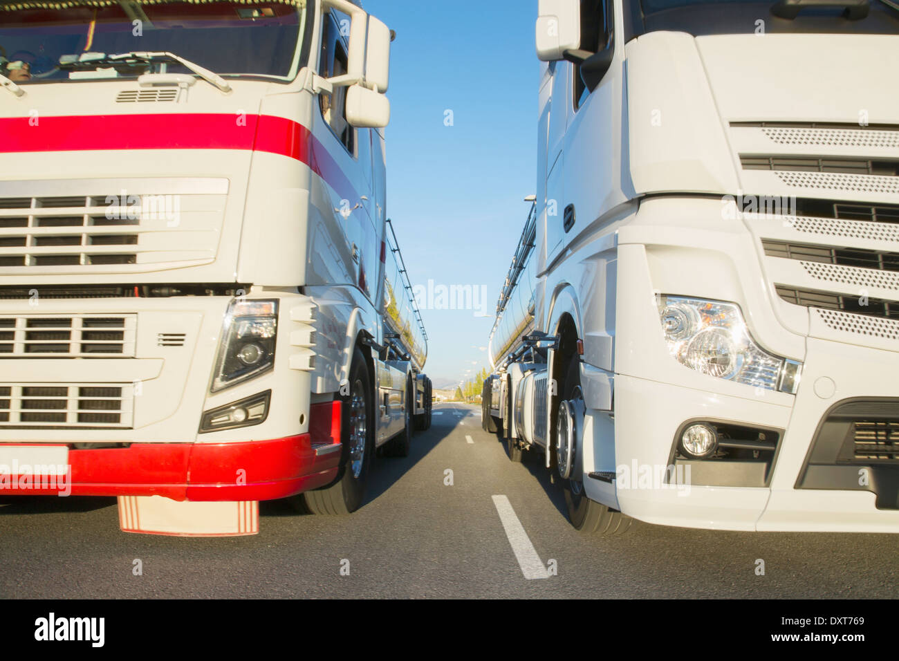 Commercial trucks side by side on the road - Stock Image