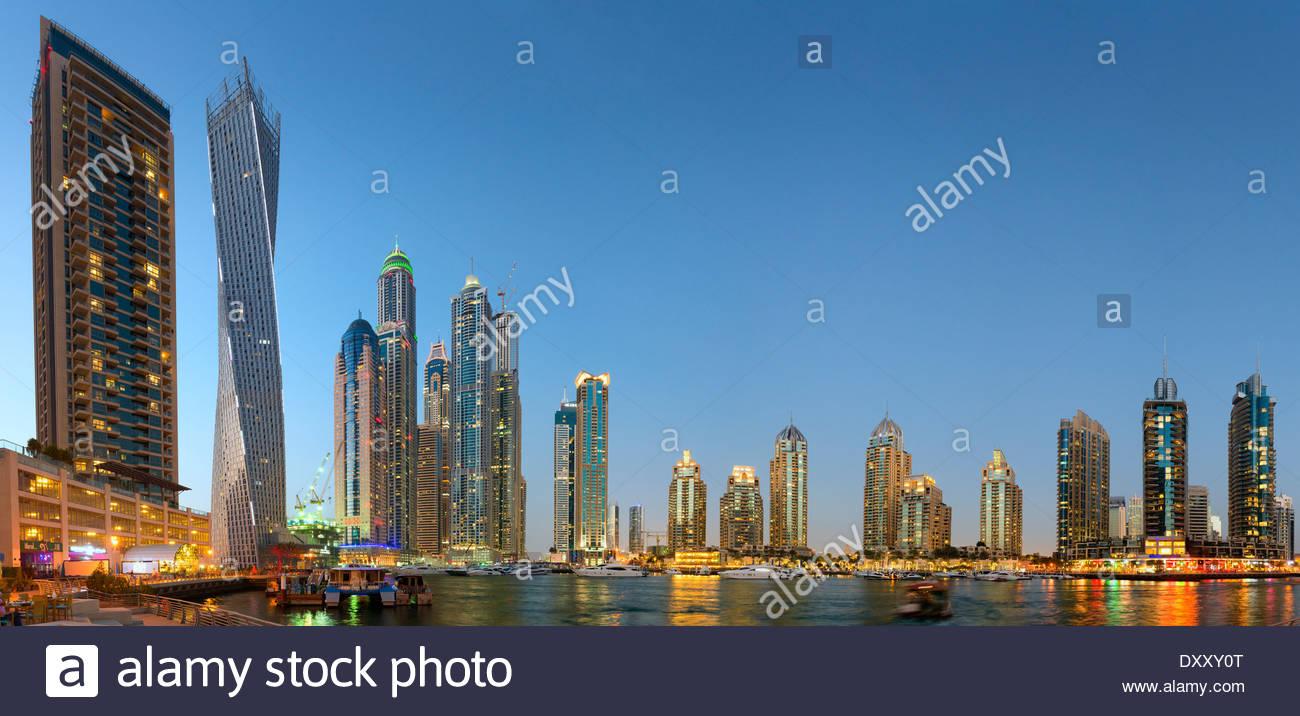 Twilight skyline view of modern skyscrapers in MArina district in Dubai United Arab Emirates - Stock Image