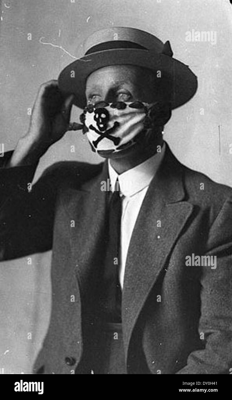 Compulsory mask, brought in to combat the flu epidemic after the World War, 1918-1919 / Sam Hood Stock Photo