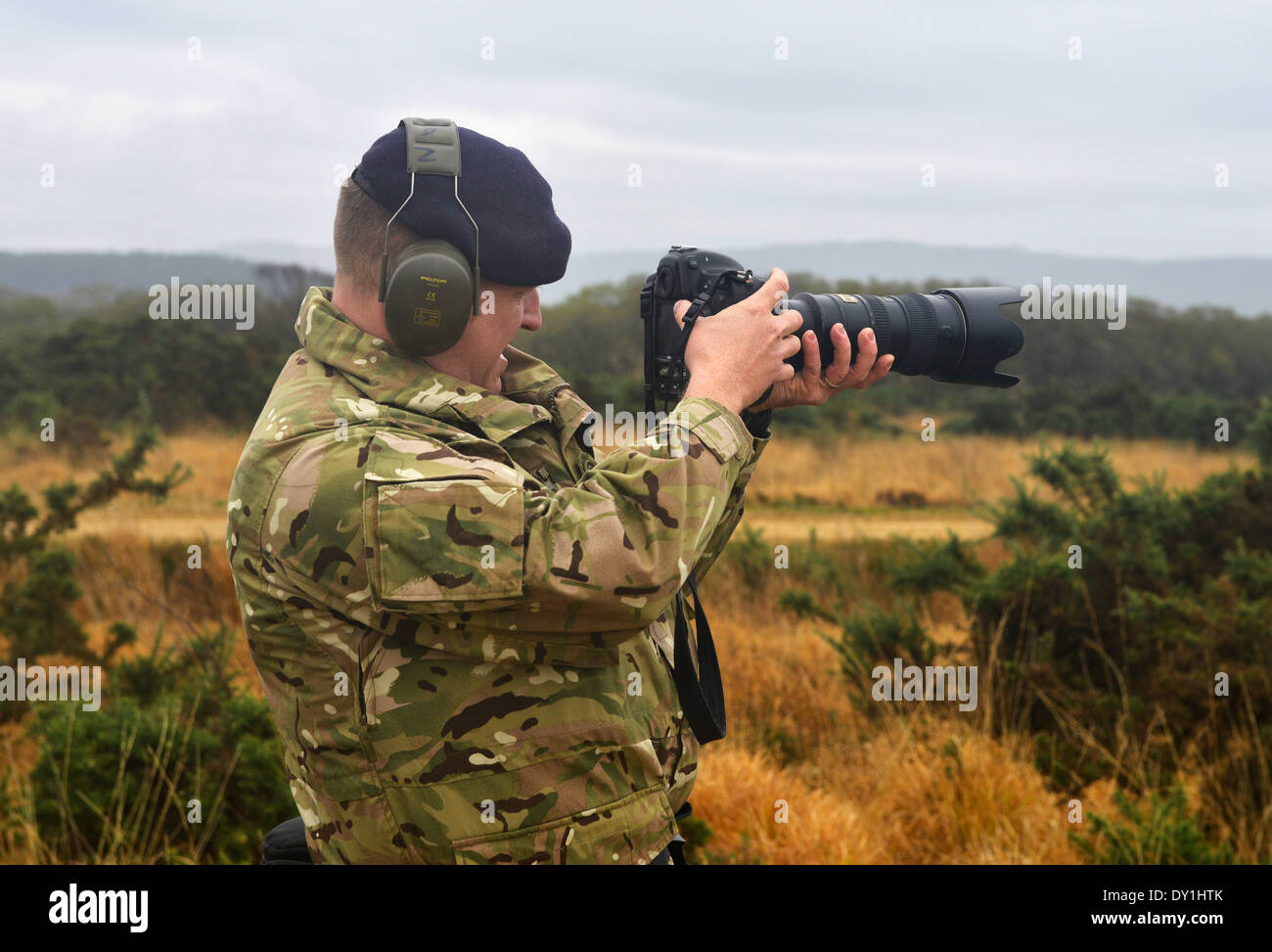 Soldier filming video with a DSLR camera, UK - Stock Image