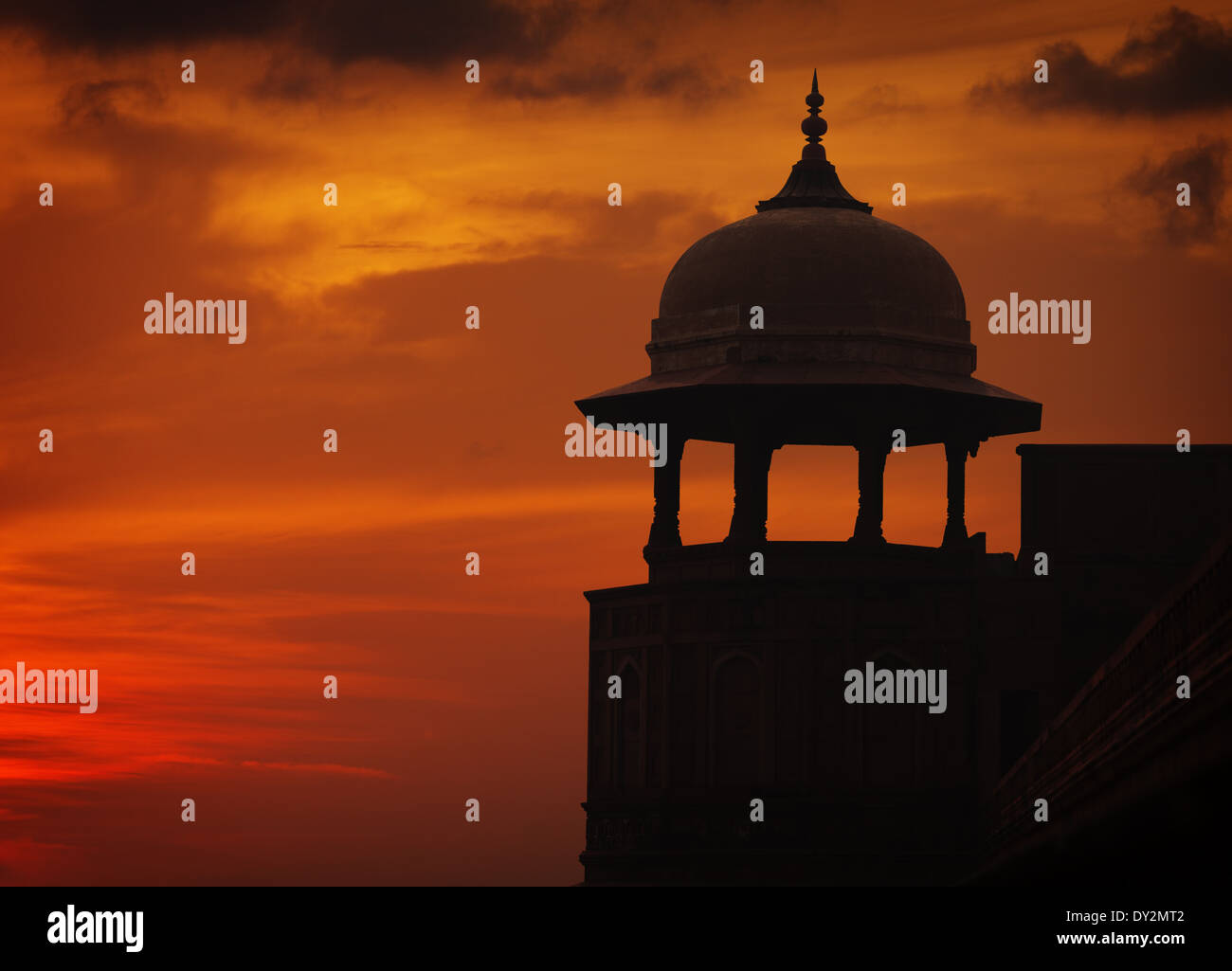 Silhouette of Asian style tower on sunset sky background, Red ford, Agra, India - Stock Image