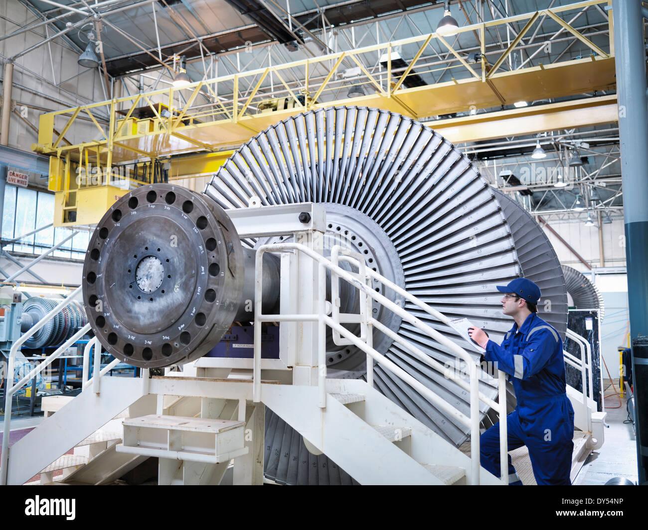 Engineer in steam turbine repair workshop - Stock Image