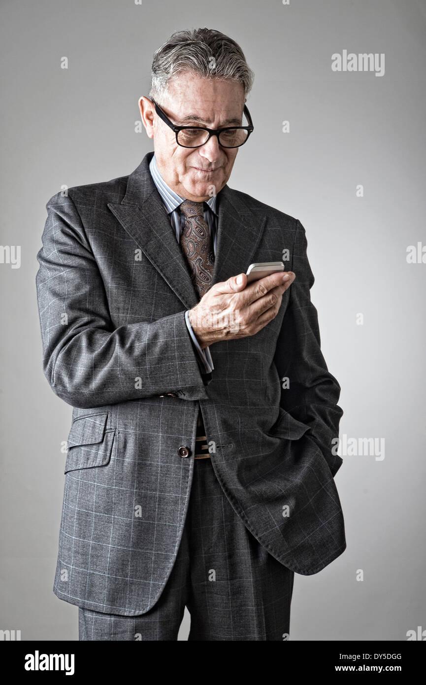 Senior man using mobile phone - Stock Image