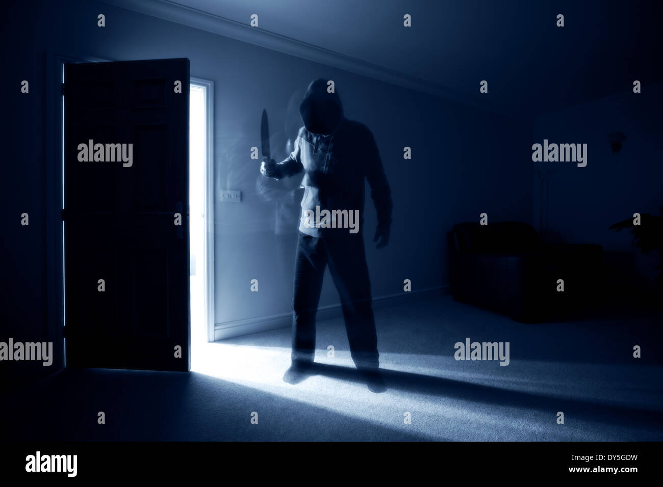 Burglar with knife - Stock Image