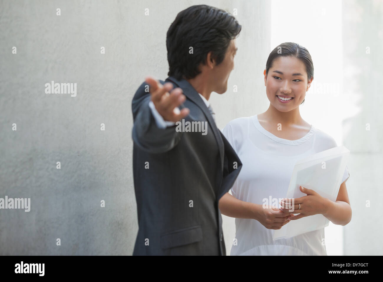 Estate agent showing buyer around - Stock Image
