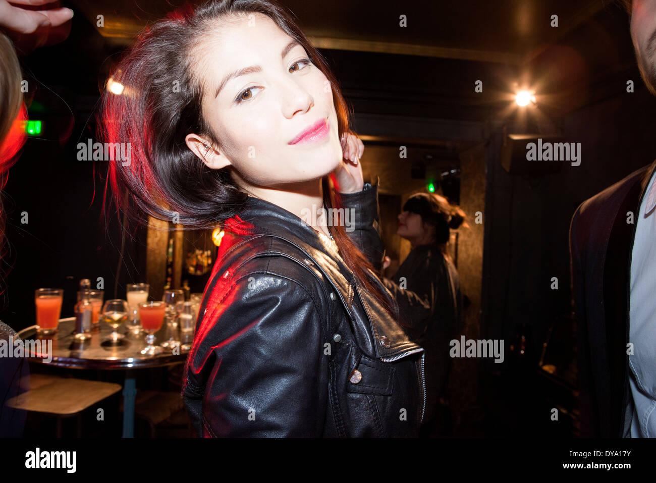 Young woman at bar - Stock Image