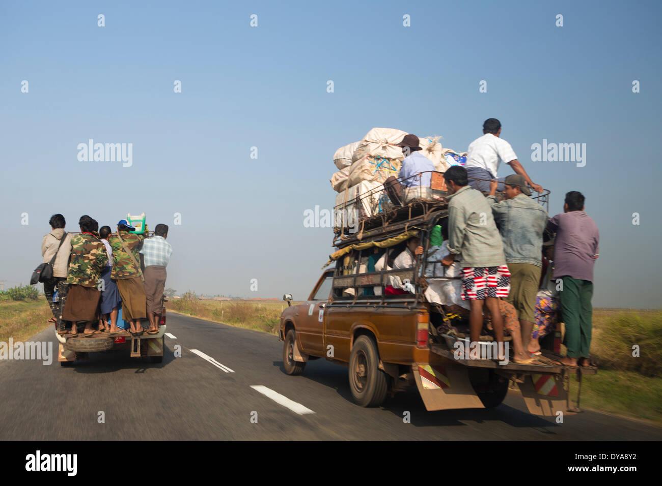 Local transport, Mon, Myanmar, Burma, Asia, dangerous, people, traffic, truck, overloaded - Stock Image