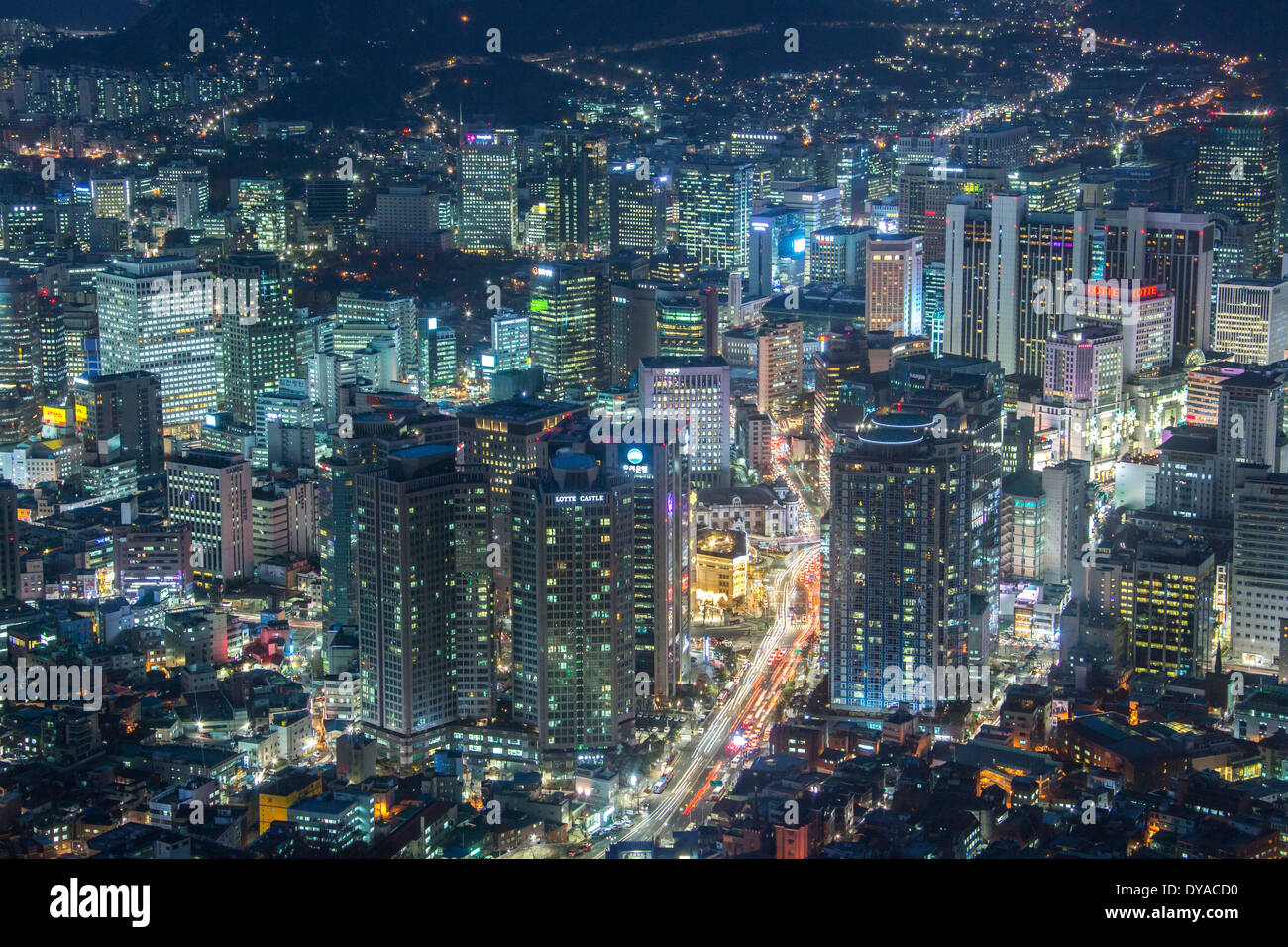Korea Asia Myeong-dong evening Seoul architecture central downtown lights metropolis urban panorama skyline skyscrapers - Stock Image