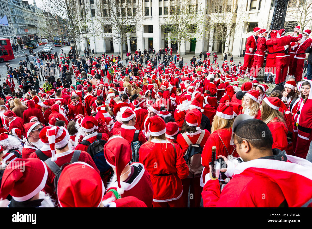 A mass gathering of Santas meeting on the steps of St Pauls Cathedral to celebrate the annual Santacon. - Stock Image