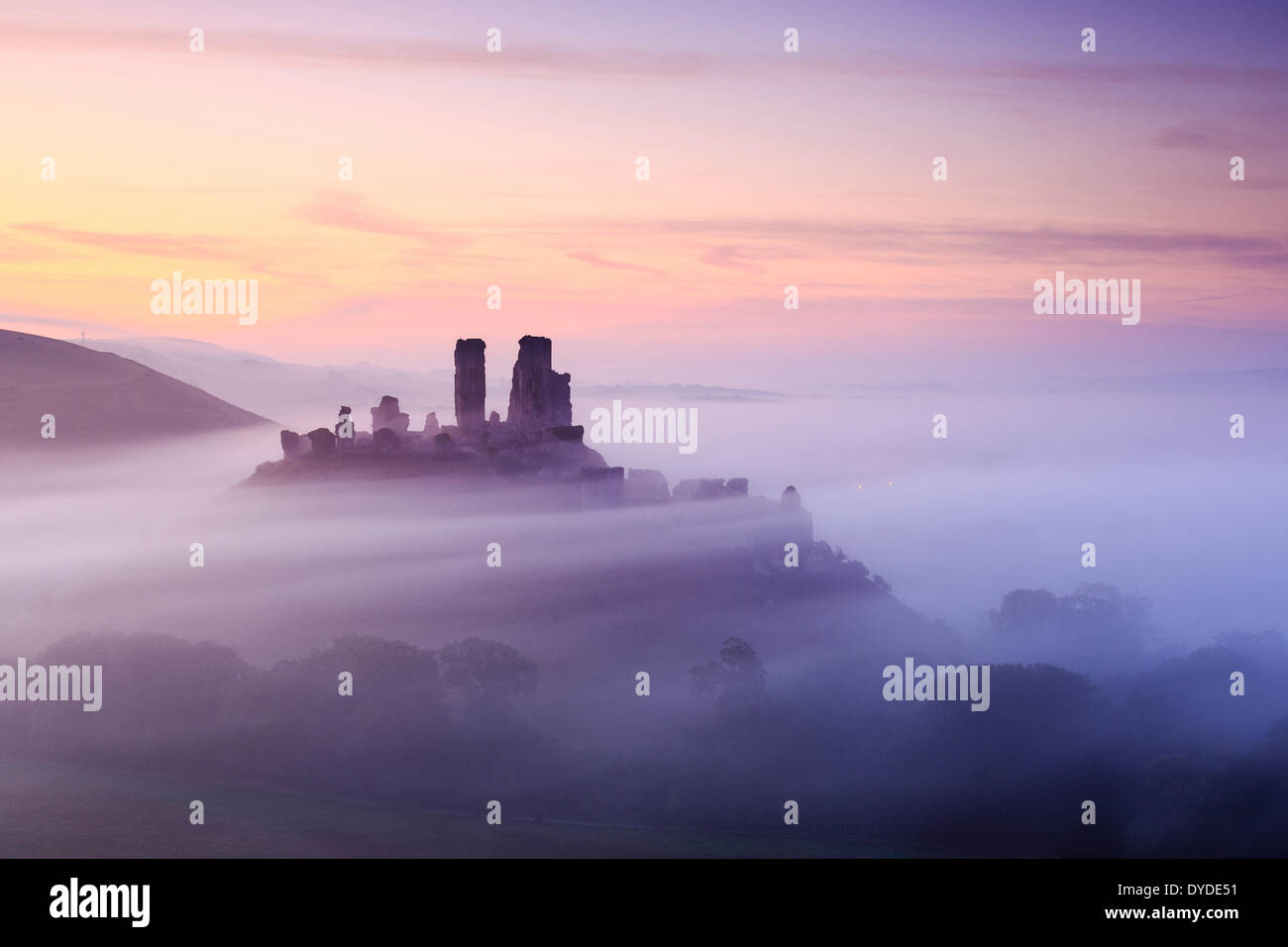 Corfe Castle in Dorset on a misty morning. - Stock Image