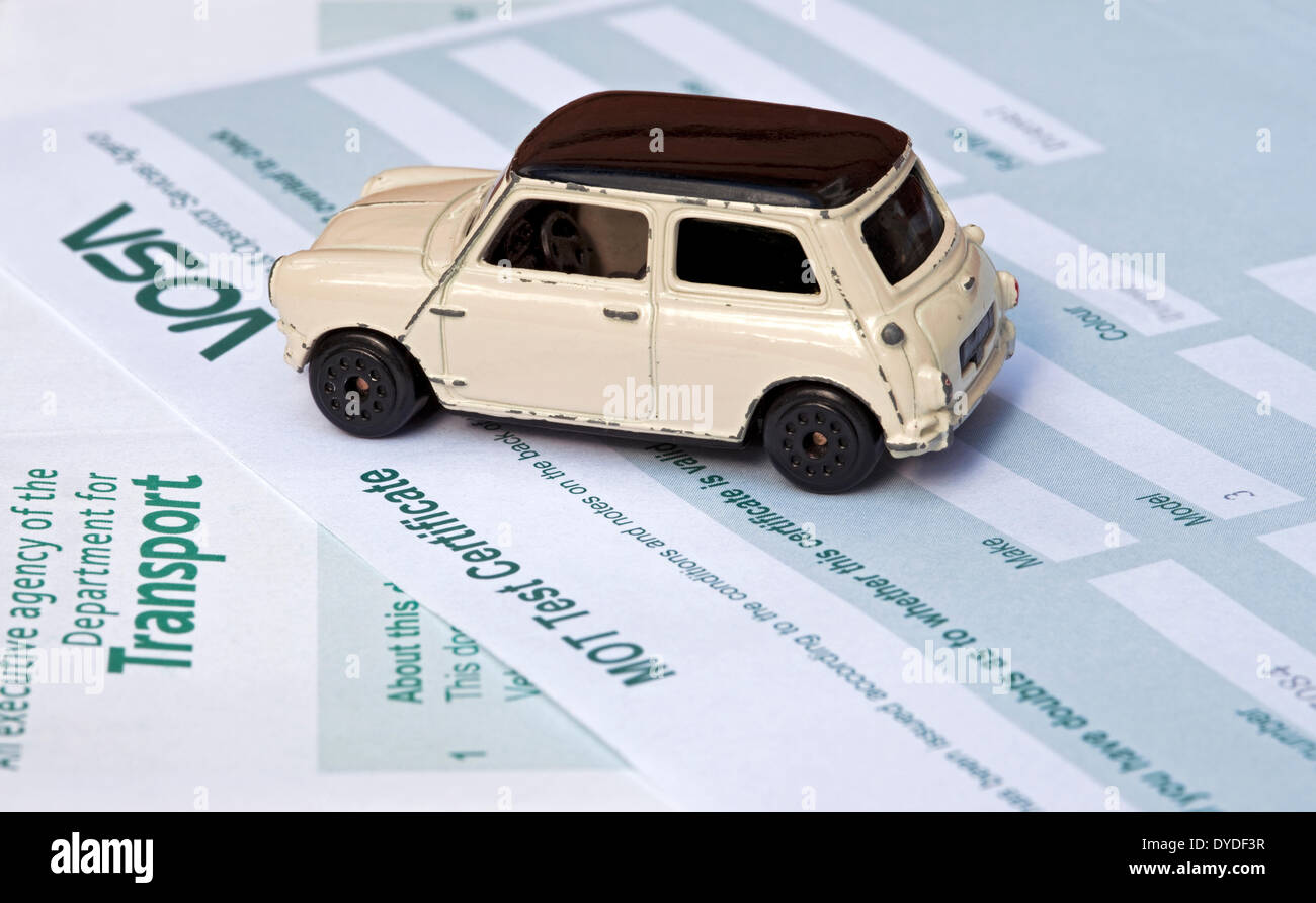 Mini Cooper Toy Car On An Mot Test Certificate Stock Photo 68524059