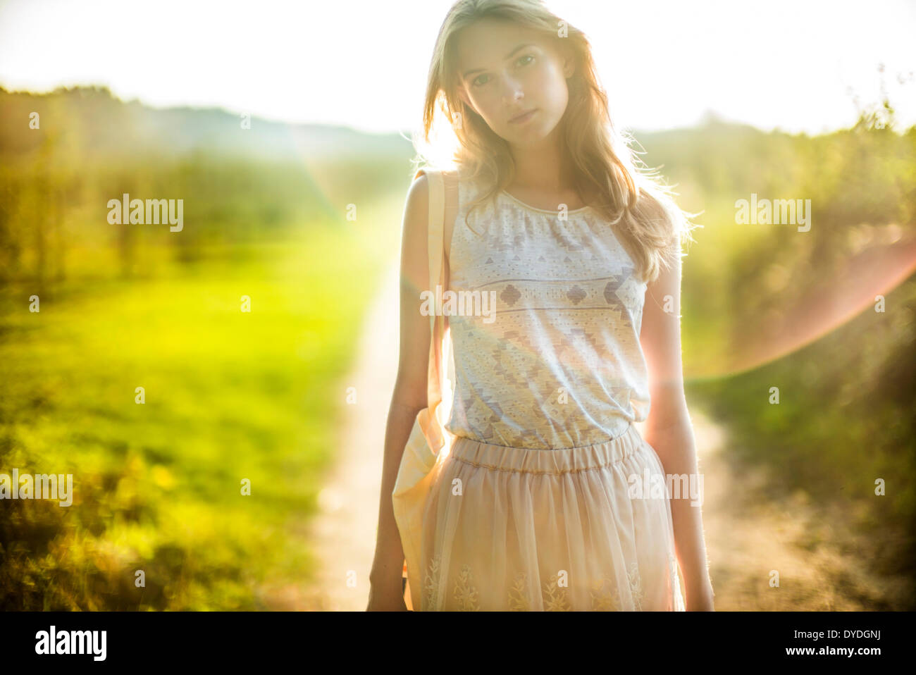 Daydreaming girl in the countryside. - Stock Image
