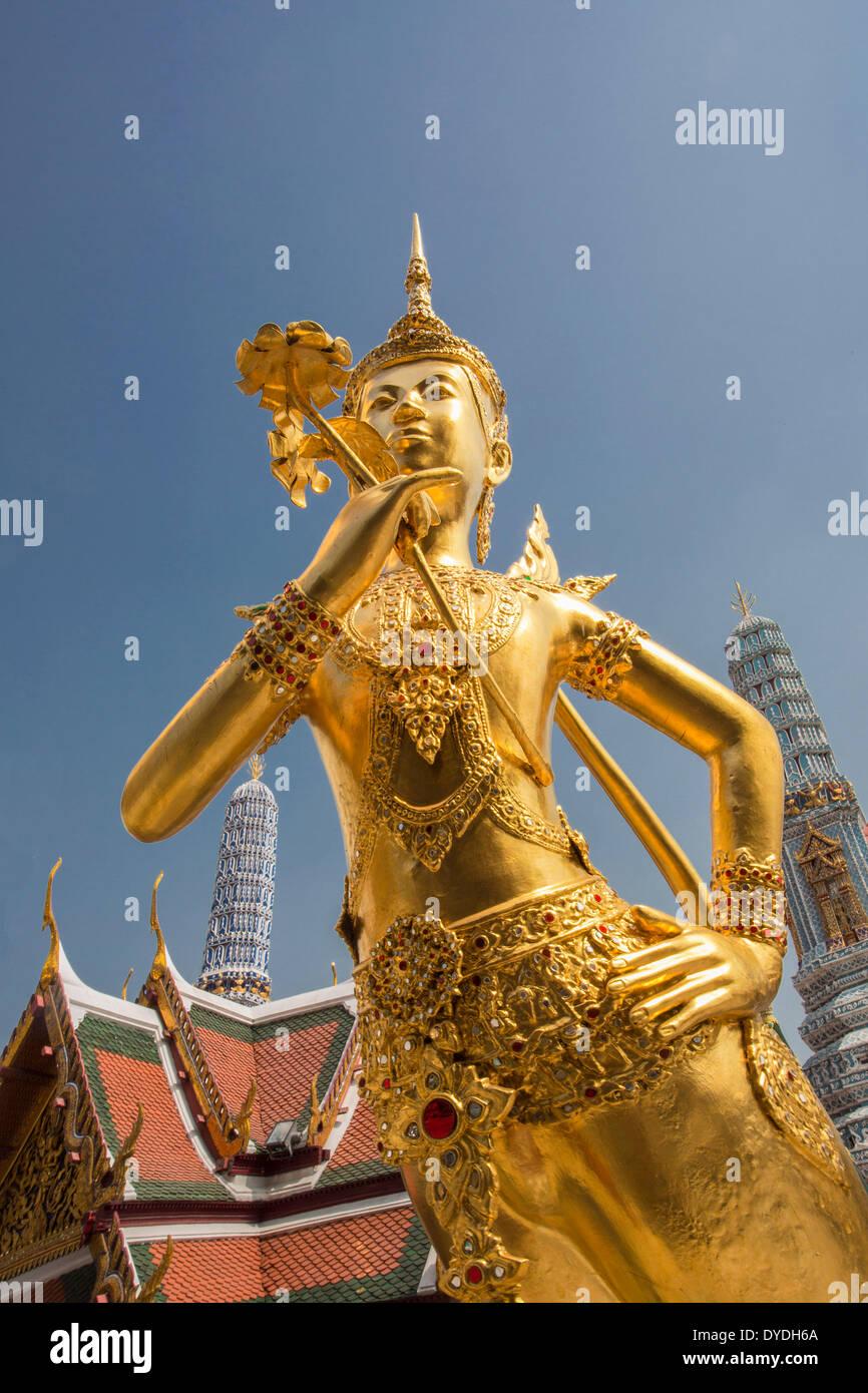 Thailand Asia Bangkok Royal Palace Wat Phra Kaew figure architecture colourful guard detail famous history mask - Stock Image